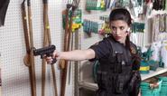 Tania Raymonde como la Oficial Carla Rinaldi