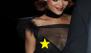 OMG! Rihanna deja asomar su pezón tras una blusa transparente